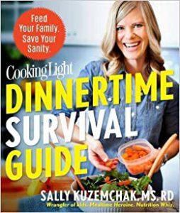 Dietitian Speaker and Author Sally Kuzemchak smiles from the cover of Cooking Light's Dinnertime Survival Guide